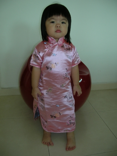 she looks great in cheongsam